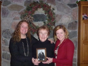 Denise Gundle-White with her mom Jeannine Gundle and sister Deanne Orlando of Farmington Hills hold a photo of their father, Don Gundle. A therapy complex was recently dedicated in his honor at Rose Hill Center residential treatment facility in Northern Oakland County. (Photo courtesy of Marx Layne & Company)
