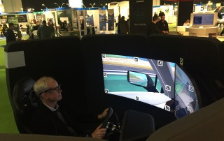Autoline Detroit host John McElroy at the NERVTeh simulator at NAIAS
