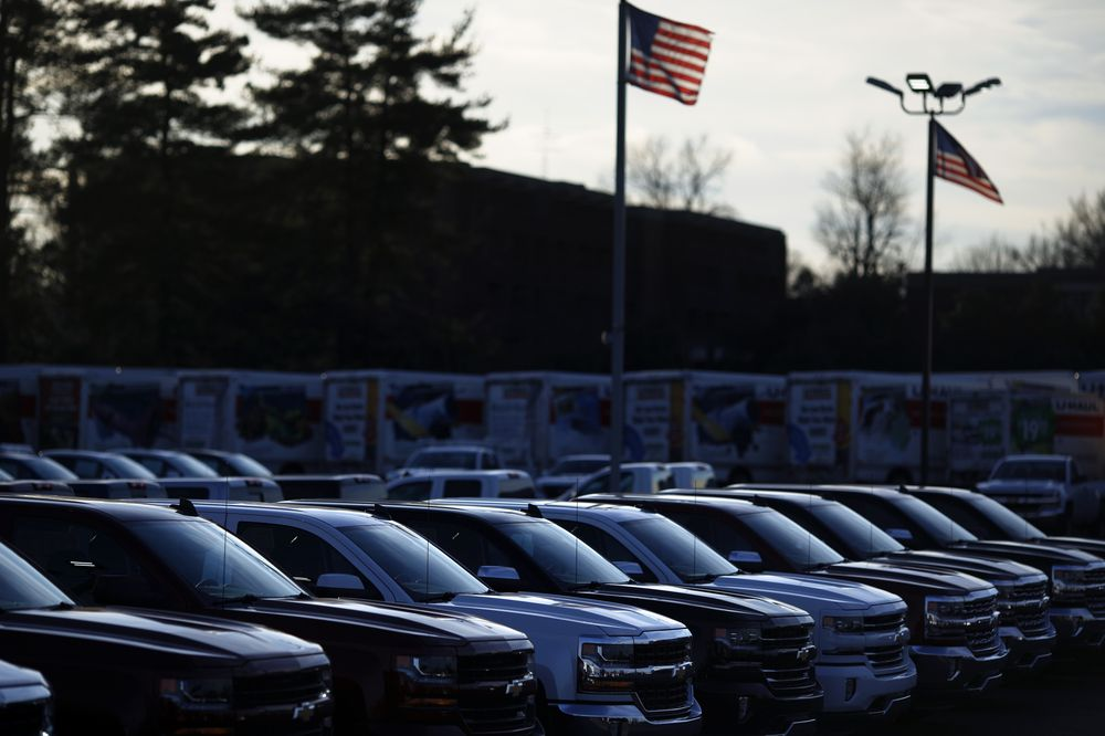 American flags fly at at a car dealership. Photographer: Luke Sharrett/Bloomberg
